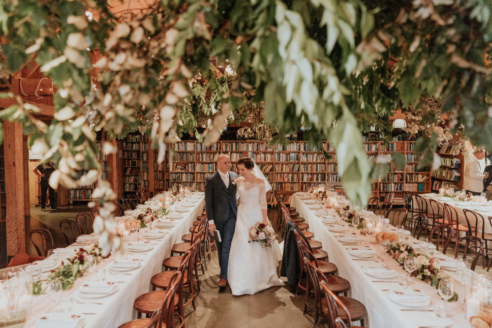 Beautiful wedding table layout/design with bride and room walking between the tables