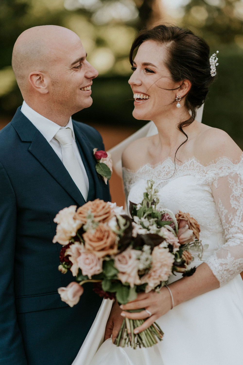 Bride and groom smiling together on their wedding day