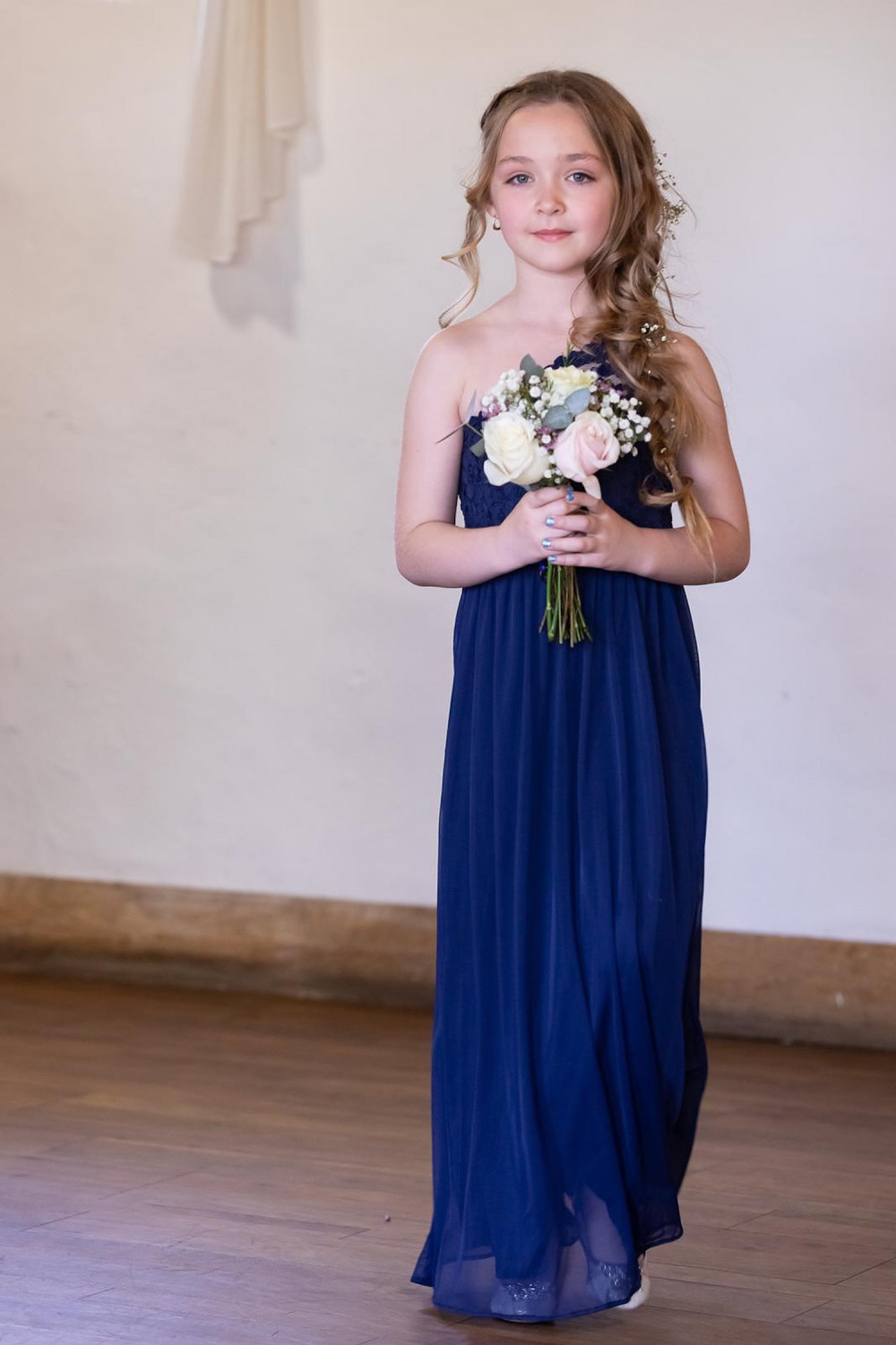 Flower girl holding flowers