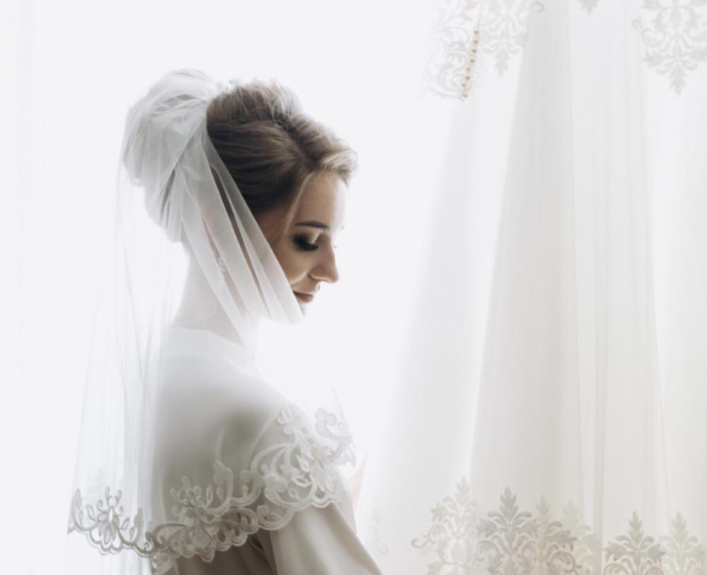 Image of bride wearing shoulder length veil
