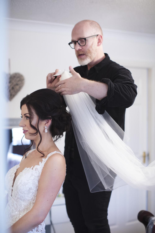 Bride having a beautiful hair style by Gavin Harvie