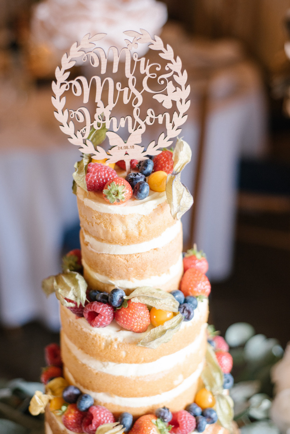 Tall layered sponge wedding cake with fruits