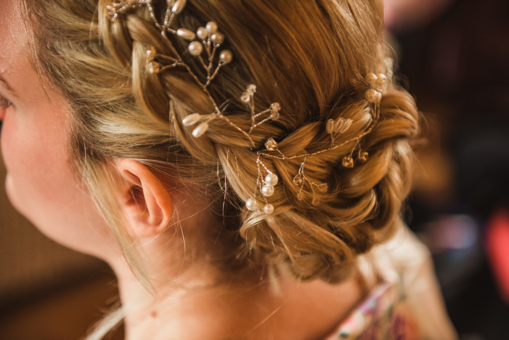 Beautiful wedding updo hairstyle with plaits and pretty silver bridal hairvine