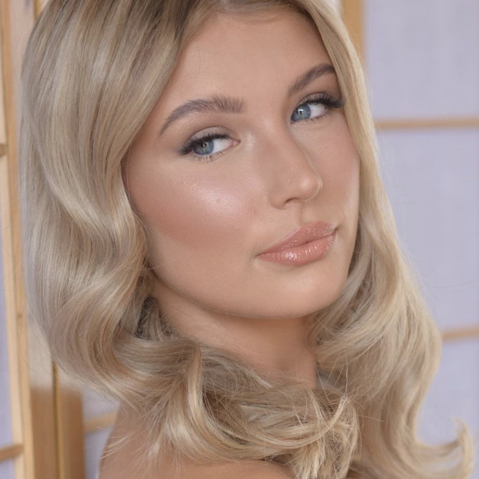 Bridal Makeup with bronze glow, peach blusher and lipstick on beautiful blonde model