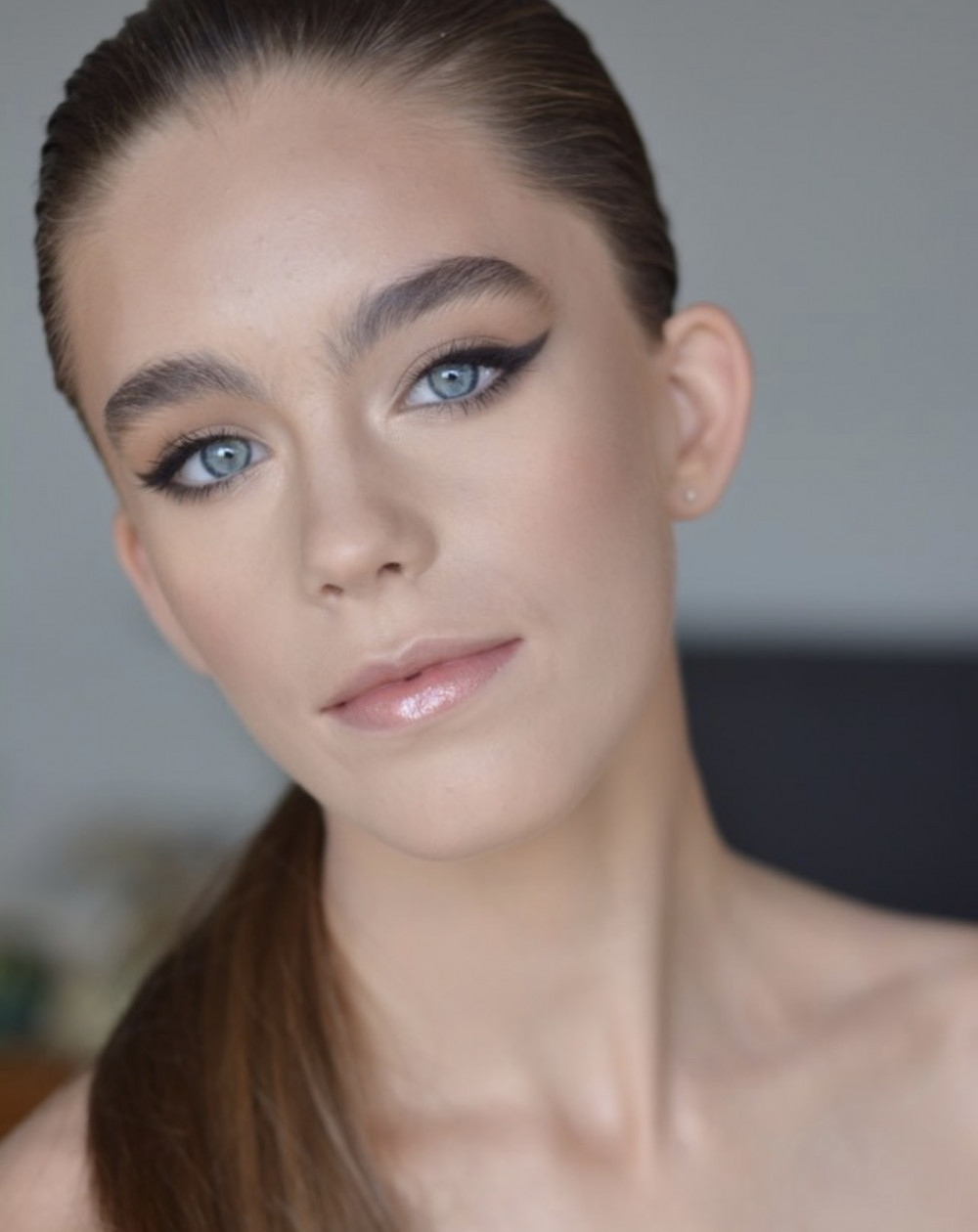 Beautiful bridal makeup with bold winged eyeliner on bride with blue eyes