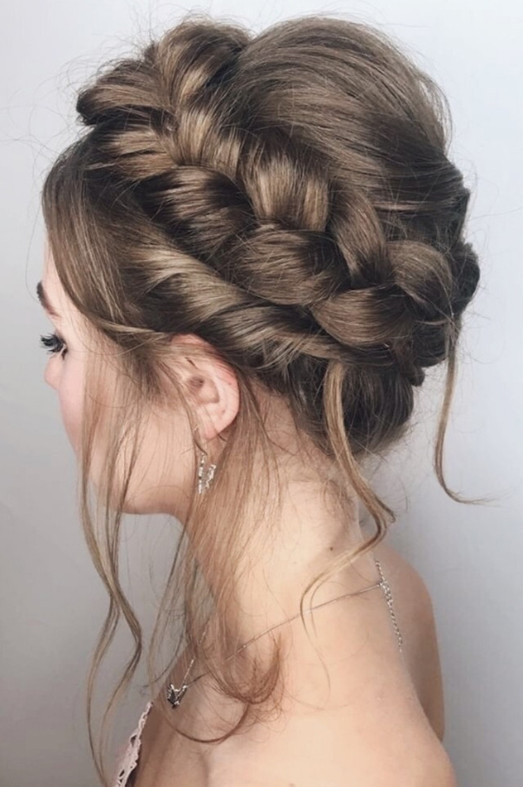 Brunette bridal hairstyle with Dutch crown braid