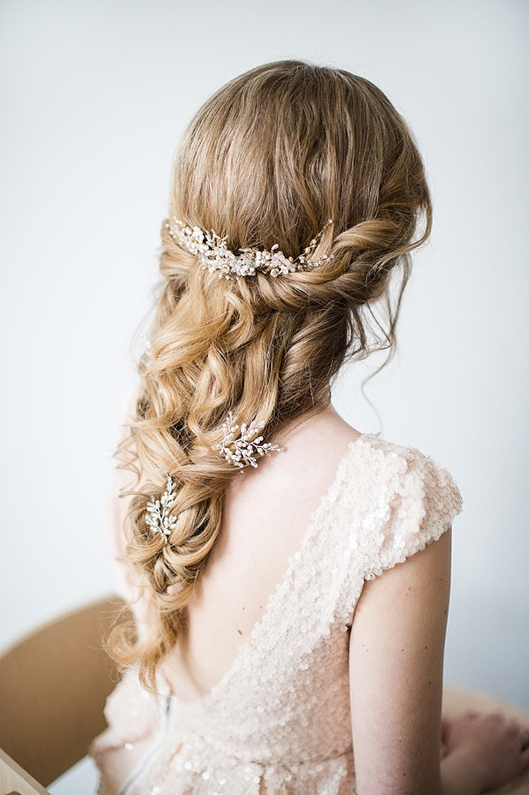 Beautiful bridal hairstyle with loose tousled plait work with a pearl hair vine.