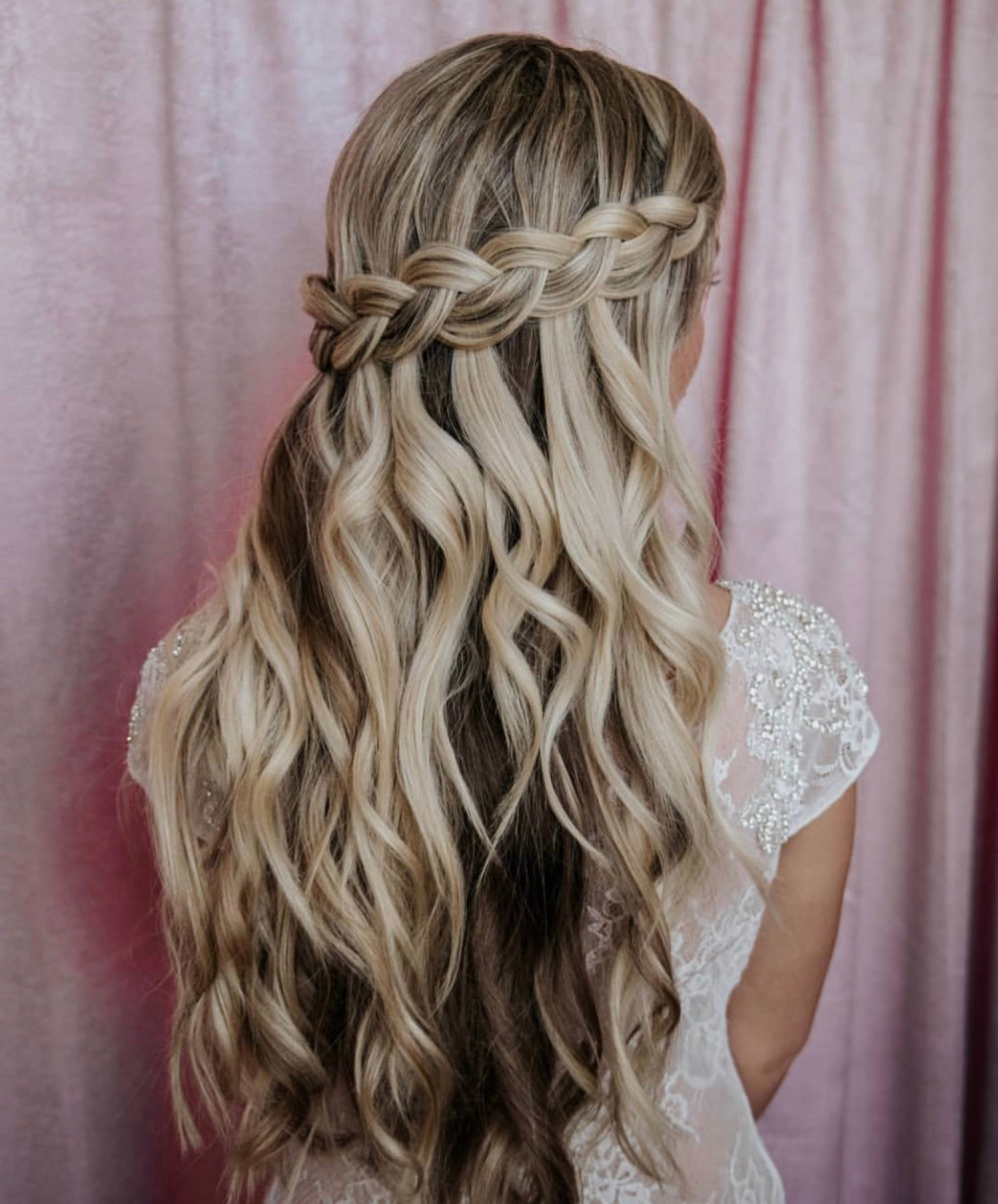 Beautiful bridal half up hairstyle with waterfall braid on highlighted hair