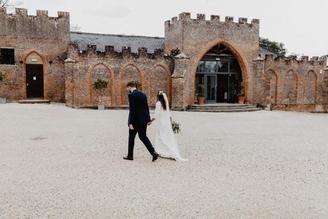 Bride and groom walking into wedding venue