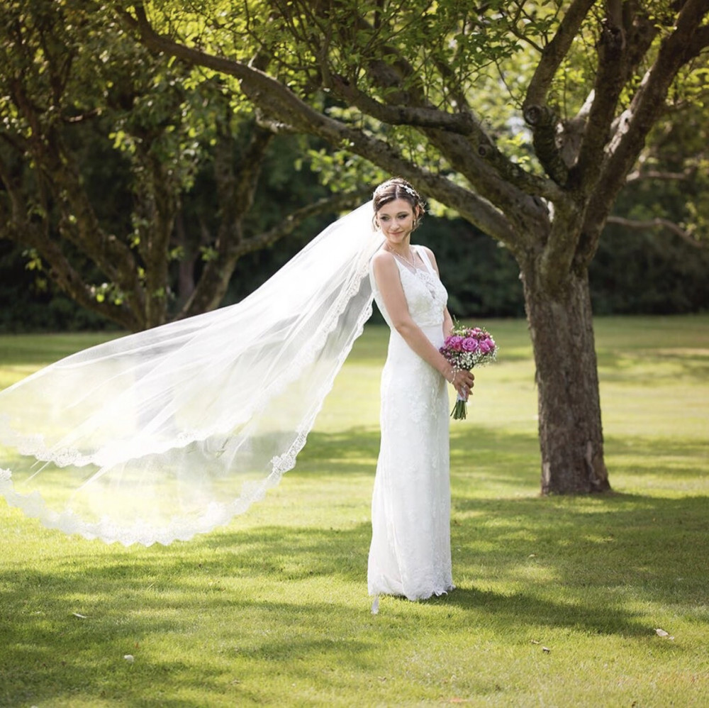 Beautiful bride wearing cathedral length veil
