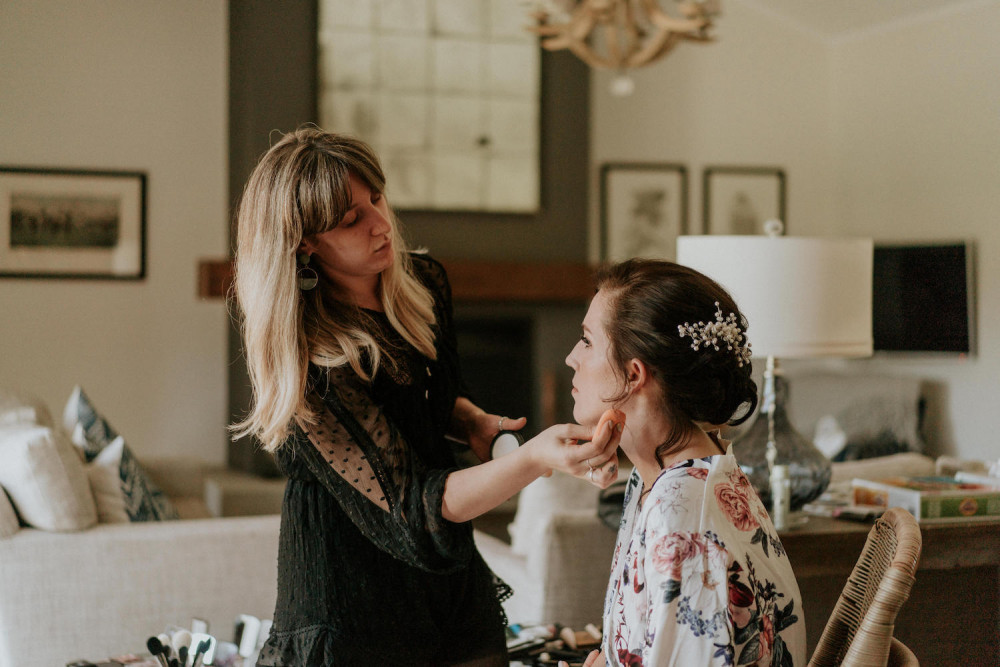 Quelle Bester doing doing Makeup on a bride.