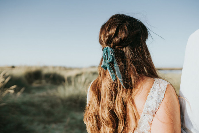 A beautiful ribbon styled into a half up half down look. Perfect for a Boho bride - Make Me Bridal Artist: Glow-Occasion Hair Specialists. Photography by: Beth beresford photography. #bohemian #boho #halfuphair #curls #bridalhair #bowinhair