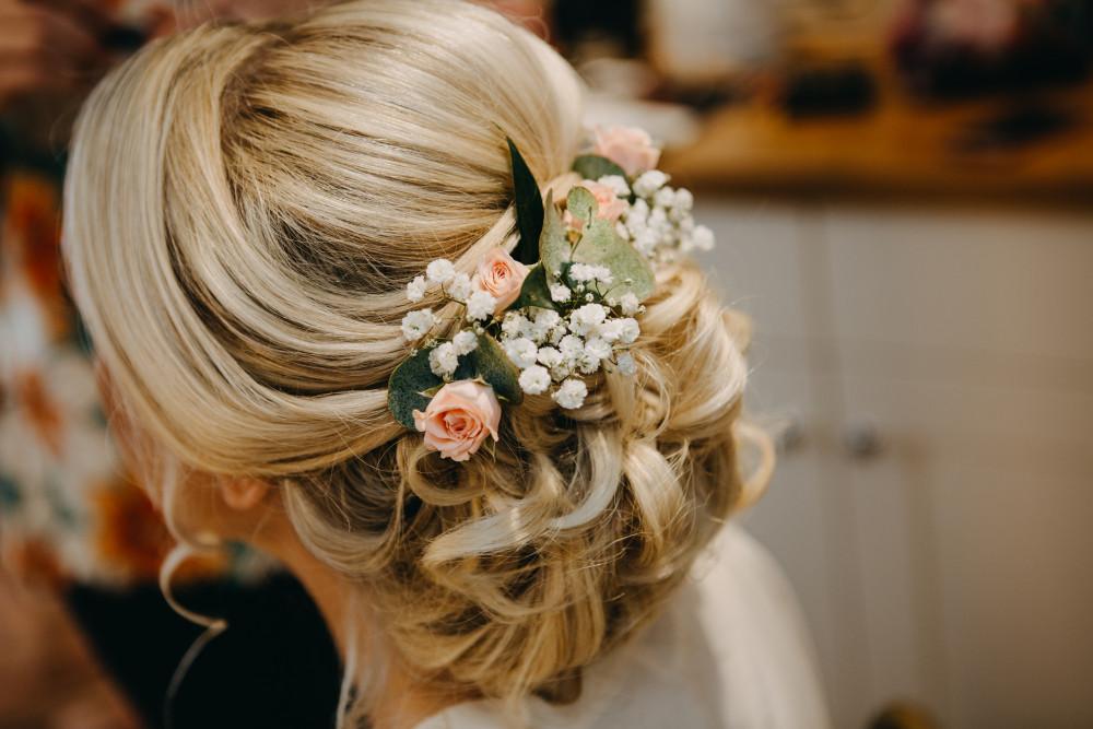 Summer bridal updo at South Farm, Royston - Make Me Bridal Artist: Cambridge Makeup Artist - Hair & Makeup. Photography by: Peter Oliver. #flowersinherhair #updo #rustic #bohohair