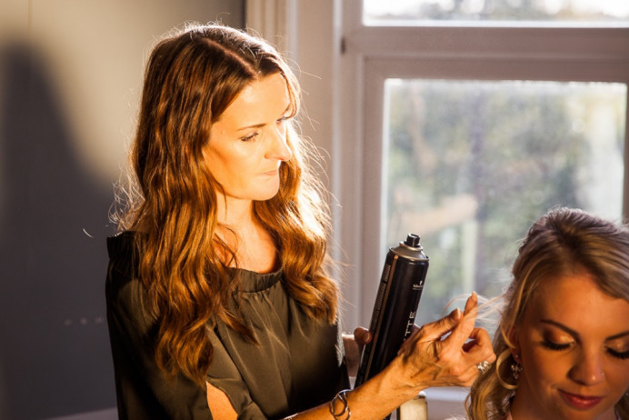 Behind the scenes shot of me preparing the bride - Make Me Bridal Artist: Head Turners - Martine Turner. Photography by: Bafana Matea. #gettingready #bridalmakeup #meatwork #bridalhair #prep #soft #bridalhairstylist #charlottetilbury #bridalmakeupartist #weddingmakeupsussex