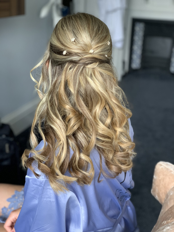 Half up half down bridal hair - Make Me Bridal Artist: Head Turners - Martine Turner. #halfuphair #bridesmaidhair #weddinghair #bridalhair #bridalhairstylist #loosecurls #bohobride #loosehairup #halfuphalfdown #bohohair #bridalhalfup