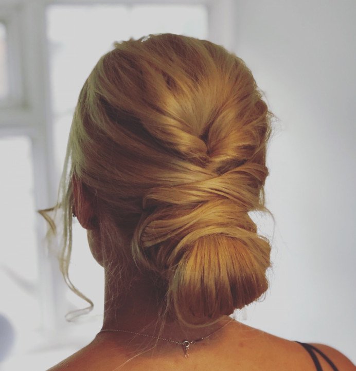 Low messy bun with a twist - Make Me Bridal Artist: Head Turners - Martine Turner. #classic #glamorous #boho #bridalhair #hairup #messybun #bridesmaidhair #lowbun #bun #bridalhairstylist #bridalhairstylist #brightonhairstylist