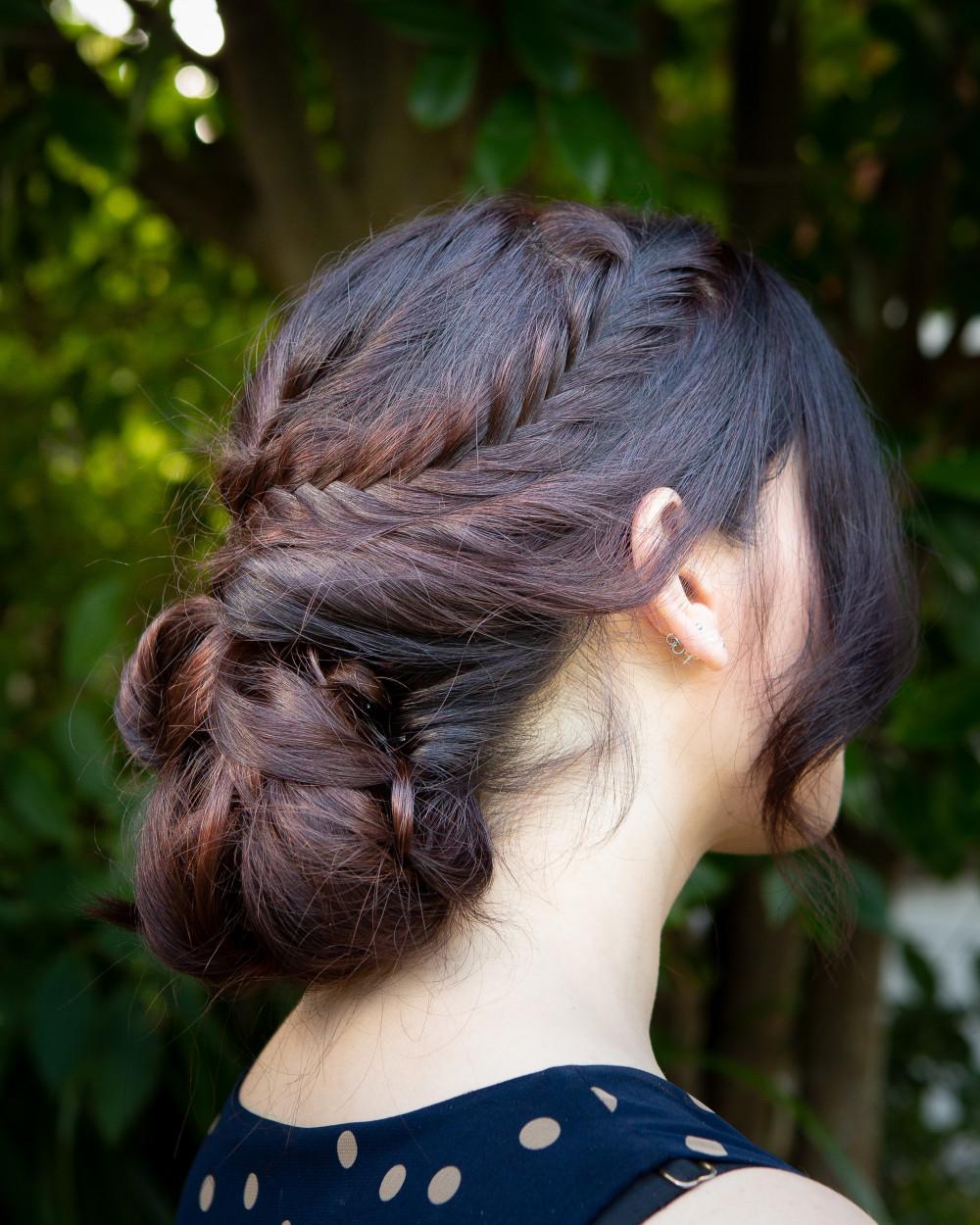 Bridal hair - Fishtail braid into low bun updo - Make Me Bridal Artist: Head Turners - Martine Turner. Photography by: Robert Bousfield. #bridesmaidhair #bridalhair #bridalhairstylist #lowbun #bridesmaidhair #weddingmakeupsussex #plaitupdo #lowupdo #braidedupdo #brunette #sussexhairstylist #bohoupdo