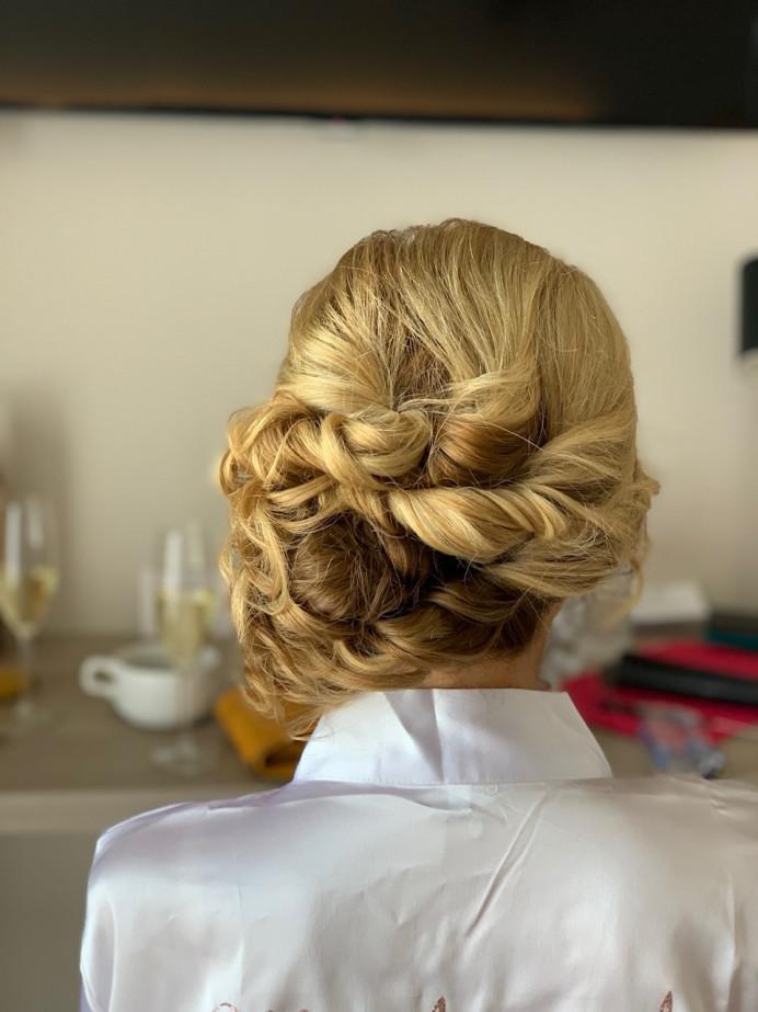 Mother of the Bride updo - Make Me Bridal Artist: Head Turners - Martine Turner. #destinationwedding #elegantupdo #curlyupdo #bridalmakeupsussex #sussexhair #sussexhairstylist #moterofthebride #twistedupdo #sidebun #blondeupdo