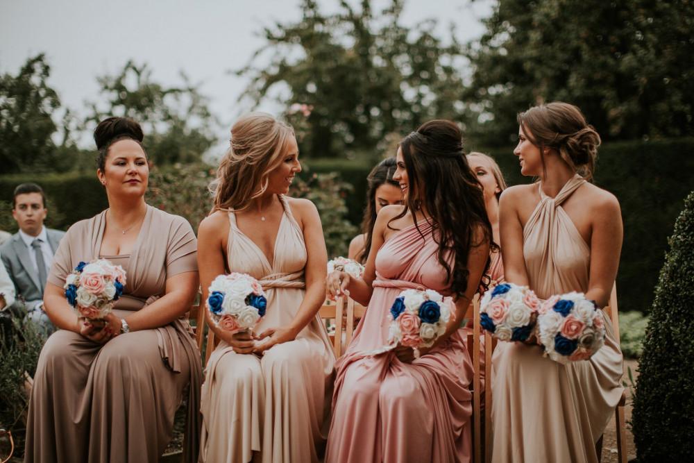 - Make Me Bridal Artist: Wedding hair by Tara. #messybun #lowbun #highbun #hairup #loosecurls #boho #halfuphair #halfuphalfdown