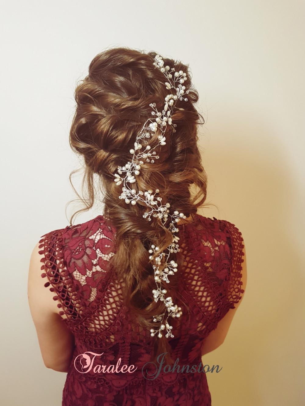 - Make Me Bridal Artist: Wedding hair by Tara.