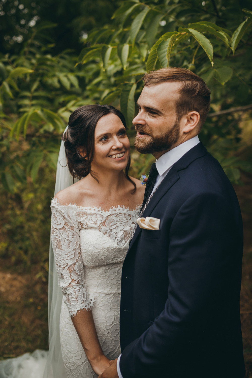 Beautiful bride and groom at Kingsettle Stud, with an intricate Bohemian-style bridal hairstyle. - Make Me Bridal Artist: Bridal Hair in Hampshire. Photography by: Mark Tattersall. #bohemian #classic #countryside