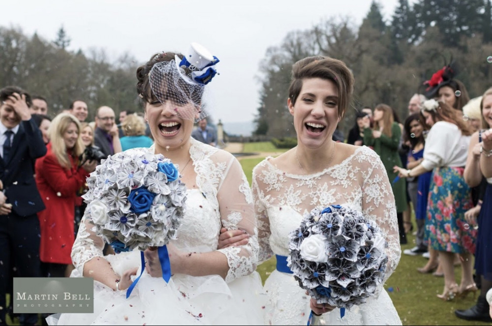 Two gorgeous brides at their Rhinefield House wedding. This wedding had such a unique, personal feel, with influences from the brides' favourite books, films, and television programmes! - Make Me Bridal Artist: Bridal Hair in Hampshire. Photography by: Martin Bell. #classic #vintage #lgbtwedding