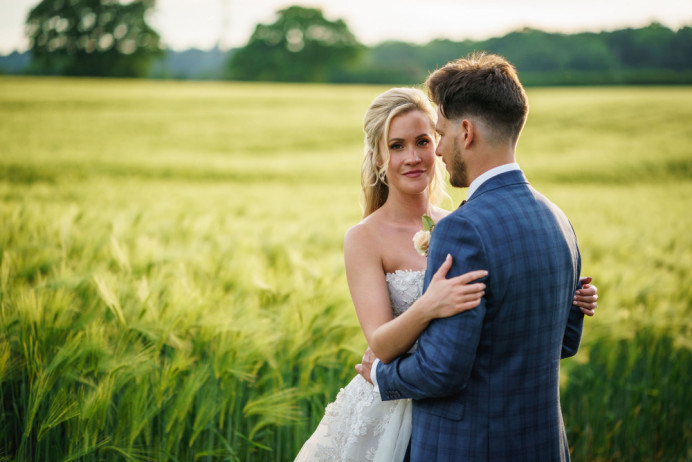 A beautiful summery countryside wedding. This gorgeous bride opted for a half-up, half-down bridal hairstyle for her golden locks. The result is absolutely stunning! - Make Me Bridal Artist: Bridal Hair in Hampshire. Photography by: Guy Collier. #classic #halfuphair #romantic #traditional