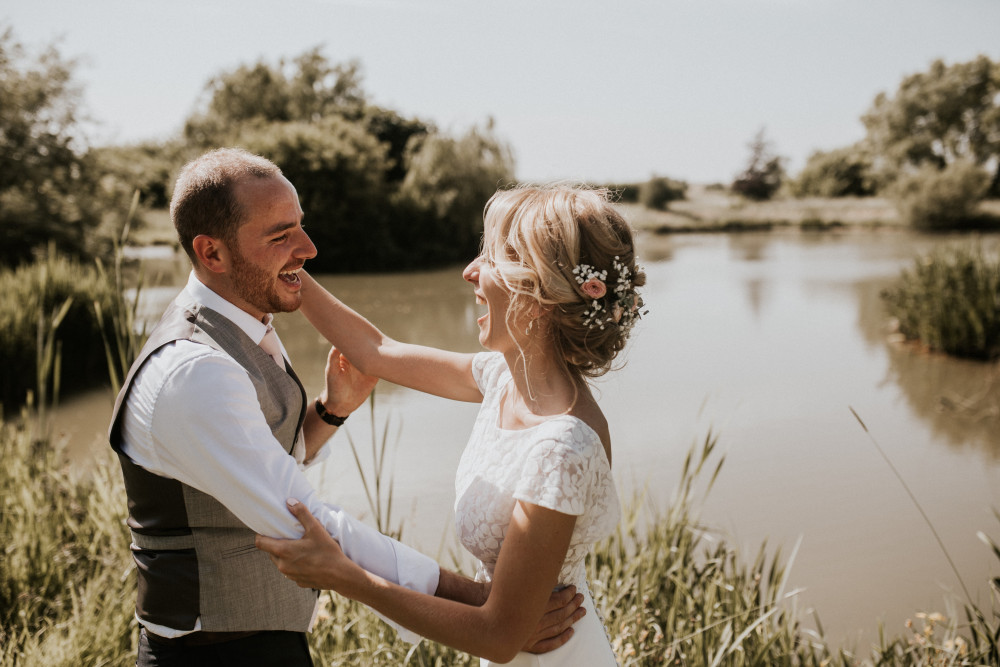 A gorgeous boho bride and her groom at their wedding at Bowerchalke Barn. - Make Me Bridal Artist: Bridal Hair in Hampshire. Photography by: Nataly J Photography. #bohemian #vintage #rustic #countryside