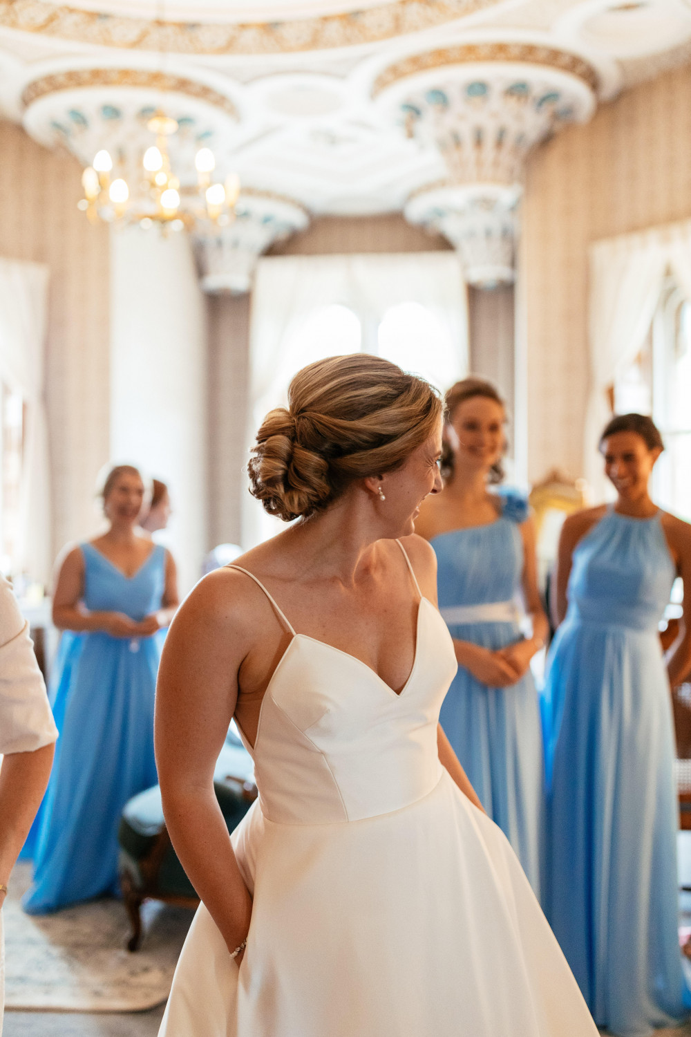 A beautiful bride at her Rhinefield House wedding, with a delicate traditional Chignon bun, perfect for incorporating her chosen veil! - Make Me Bridal Artist: Bridal Hair in Hampshire. Photography by: Suzy Wimbourne. #classic #vintage #romantic #chignon