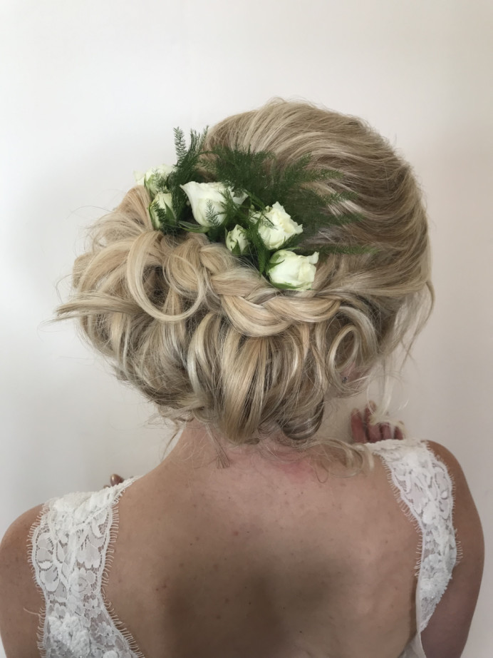 Beautiful tousled elegant updo with plait and flowers  using extensions for extra volume - Make Me Bridal Artist: Sapphire Styling hair and makeup . #boho #naturalmakeup #blonde #roses #weddingmorning #bridalhair #flowersinherhair #updo #romantichairup