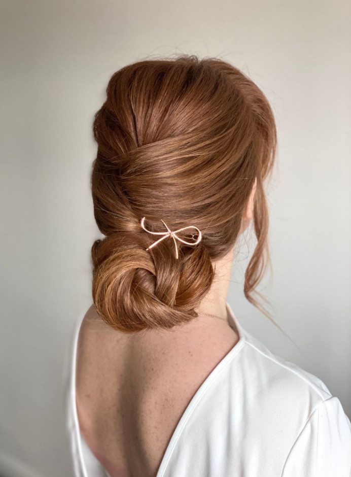 Soft, modern chignon - Make Me Bridal Artist: Laura Anne Hair & Makeup Designer. Photography by: Laura Anne. #chignon #lowbun #redhead #modernhair #bridalupdo