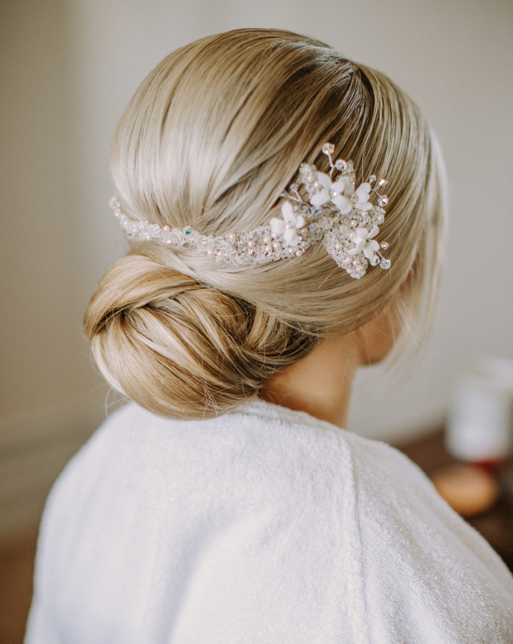 Textured low chignon by Emma of Beauty Ninjas, with hair accessory by Ritz & Sass. - Make Me Bridal Artist: Beauty Ninjas. Photography by: Marcel Grabowski. #classic #blonde #chignon #bun #lowbun #texturedupdo #textured #texturedbun #lowchignon