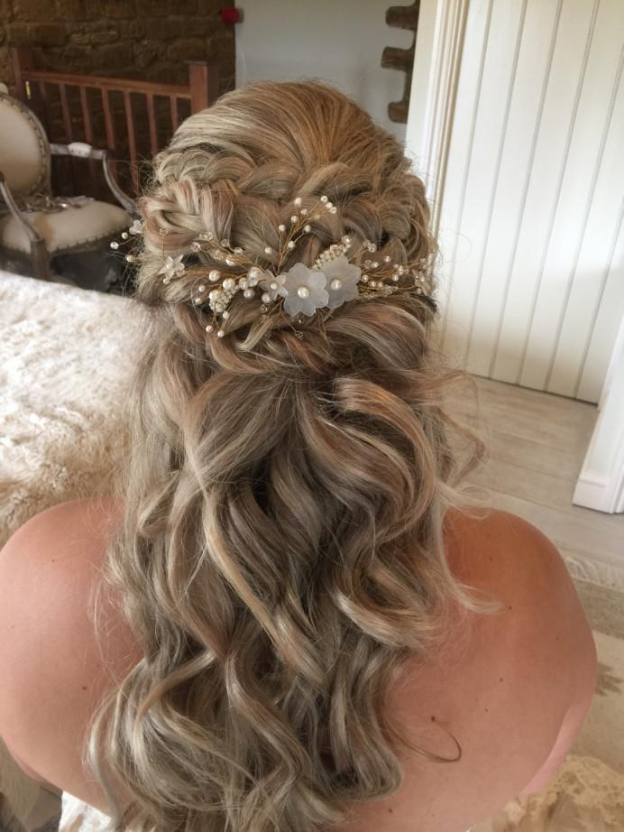 An elegant yet rustic bridal hairstyle - Make Me Bridal Artist: The Hairbook. #vintage #glamorous #boho #halfuphair #curls #blonde #hairvine #bridalhair #weddinghair