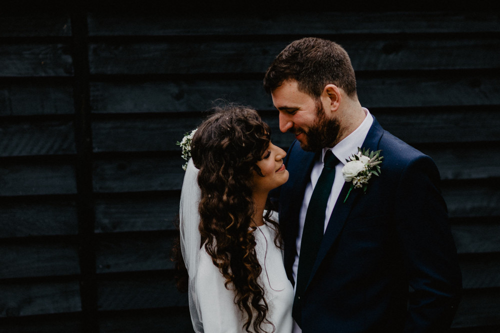 2019 bride with naturally curly hair. We worked with Megan's natural texture and added some natural flowers. - Make Me Bridal Artist: Cheveux cimone. Photography by: Benjaminstuart photography . #bohemian #boho #curly #curlyhair