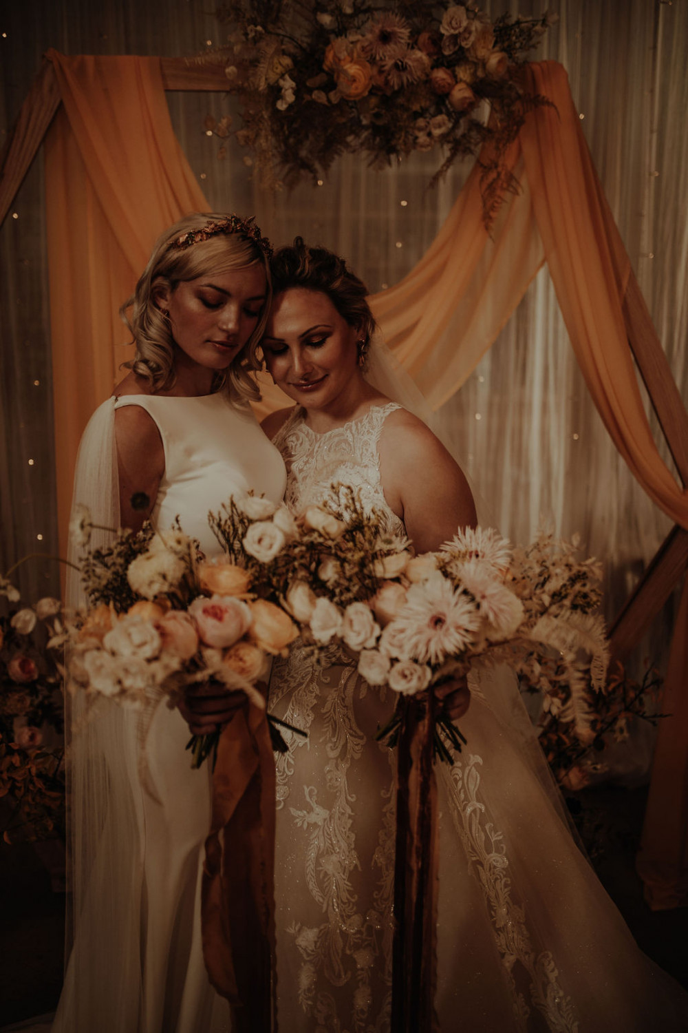 Each bride had different styles to reflect their individual preferences and styles, but both had radiant skin and wore accessories by Saint Beth Official. - Make Me Bridal Artist: Chrys Chapman. Photography by: Esme Whiteside. #boho #romantic #glowingskin #twobrides #sleekhair