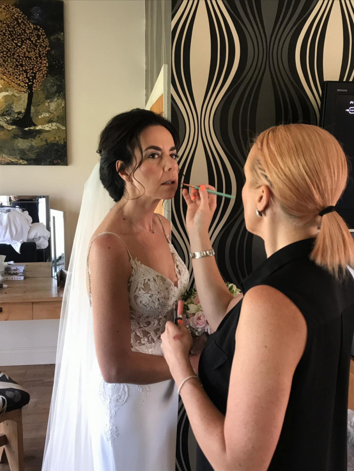 Me at work applying lipstick very carefully for the final touch up. Photo taken by the hair dresser. - Make Me Bridal Artist: PosiTIVEYly Peachy Makeup, Beauty, Health . #bridalmakeup #meatwork #weddingmakeup #meinaction