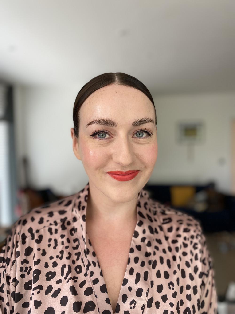 Natural makeup with a twist - Make Me Bridal Artist: Flaming Bride. #classic #glamorous #naturalmakeup #redlip #eyeliner #dewyskin #glowingskin #orangelip #naturalskin #neon