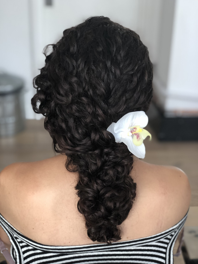 Curls washed and blow dried and then styled - Make Me Bridal Artist: Flaming Bride. #curls #flowersinherhair #naturalhair #curlyupdo