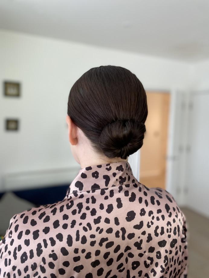 Sleek, effortless bun - Make Me Bridal Artist: Flaming Bride. #bridalhair #bun #sleek #sleekhair #modernbride