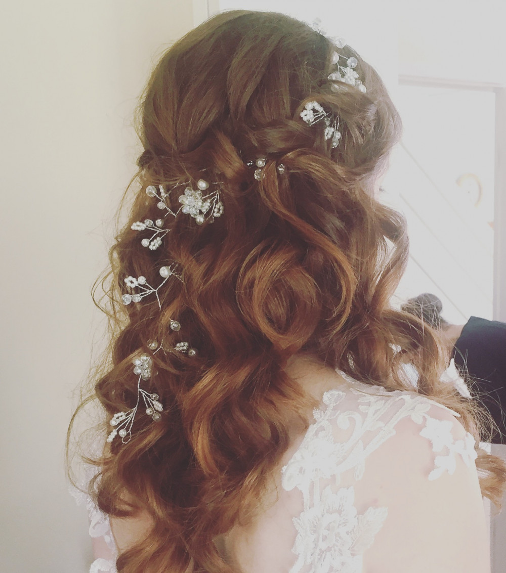 A classic romantic half up, half down style with soft curls and a hair vine woven through. - Make Me Bridal Artist: Lee O'D Makeup & Hair. Photography by: Lee O'D. #boho #halfuphair #hairvine #redhead #romantic #redhair #halfuphalfdown #softcurls #auburn