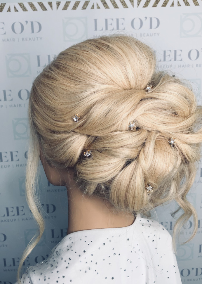 A glamourous, modern updo with swarovski star hair pins. - Make Me Bridal Artist: Lee O'D Makeup & Hair. Photography by: Lee O'D. #updo #blonde #glamourous #glambride #blondehair #hairpins