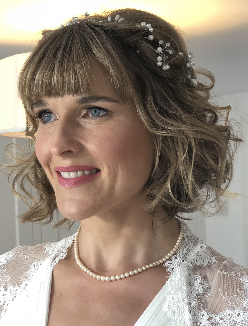 Natural, glowing skin and soft curls for this beautiful bride. - Make Me Bridal Artist: Lee O'D Makeup & Hair. Photography by: Lee O'D. #dewyskin #glowingskin #softcurls #shorthair #bob #shorthairbride #maturebride