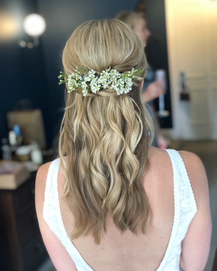 Effortless waves in a twisted half up, decorated with hand placed Gypsophila. 
