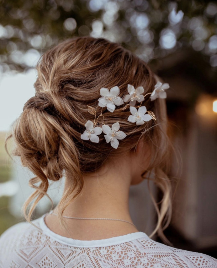 Lovely soft, effortless up do styled in a bun with loose pieces. - Make Me Bridal Artist: The Boho Bride . #bridalhair #bridesmaidhair #bohobride #bohowedding #softupdo #looseupdo #bohemianhair