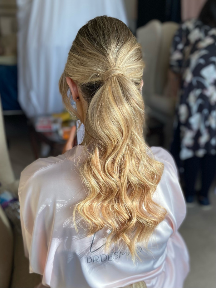 Modern waved ponytail with lots of shine. - Make Me Bridal Artist: Jessica Makeup and Hairstyling. #relaxedupdo #hairup #weddinghair #bridalhair #ponytail #sleekhair #modernbride #hampshirehair #hampshirewedding #surreyhair #surreywedding #surreyhairandmakeup
