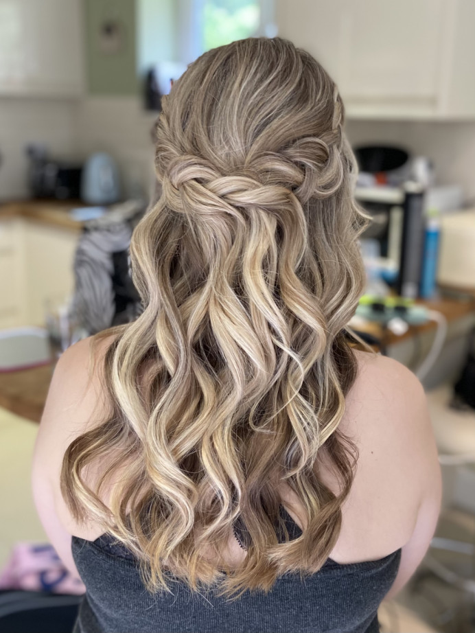 Loose waves half up half down with plaits - Make Me Bridal Artist: Jessica Makeup and Hairstyling. #halfuphair #bridalhair #plaits #loosewaves #hampshiremakeupartist #hampshirehair #surreyhair #weddingsurrey