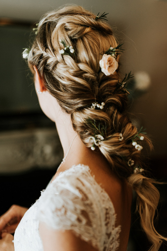 Loose soft looking braid with plaits and fresh flowers. - Make Me Bridal Artist: Jessica Makeup and Hairstyling. Photography by: Aljaz Hafner. #bohemian #bridalhair #flowersinherhair #rustic #relaxedupdo #braid #bridalhairstylist #plaits #flowers