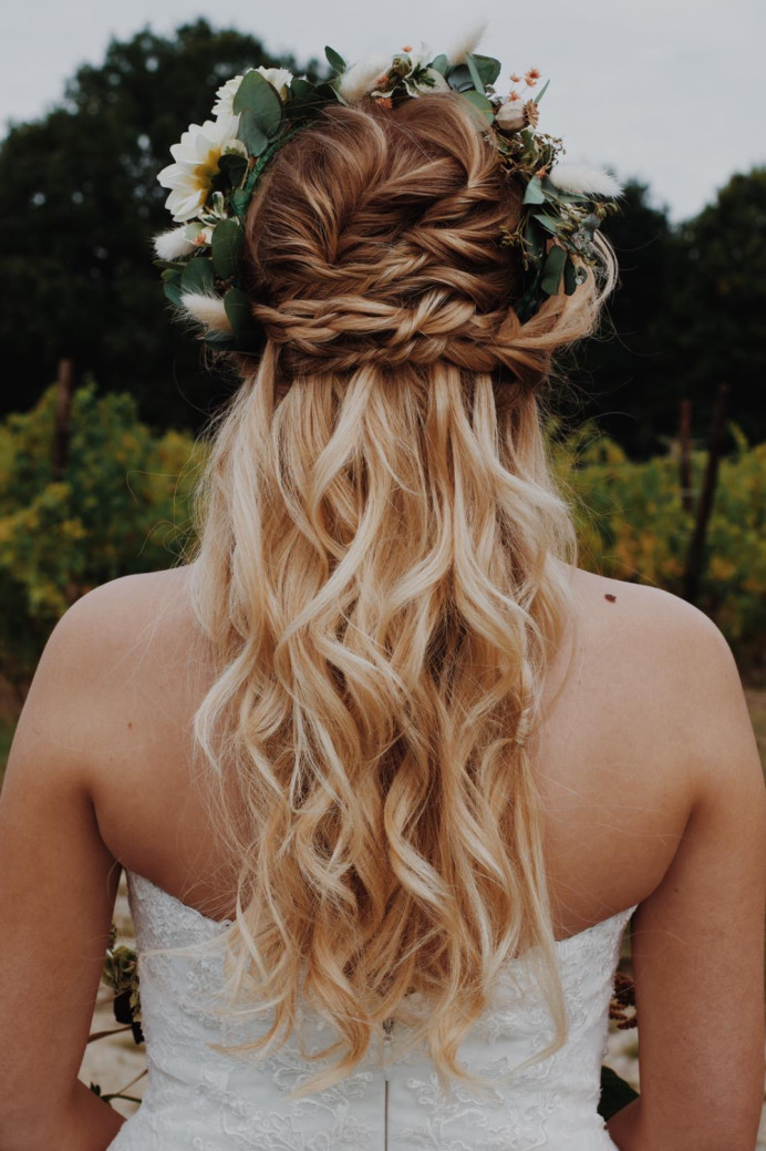 An effective boho style, half up wedding hair with added interest - using braids and twists - Make Me Bridal Artist: Pretty Please by Katie. Photography by: Phoebe Mills. #bohemian #bridalhair #flowersinherhair #romantichairup #braidedupdo #fishtailbraid #bohobride #bohowedding #undone #bohowaves #beachywaves #mermaidwaves