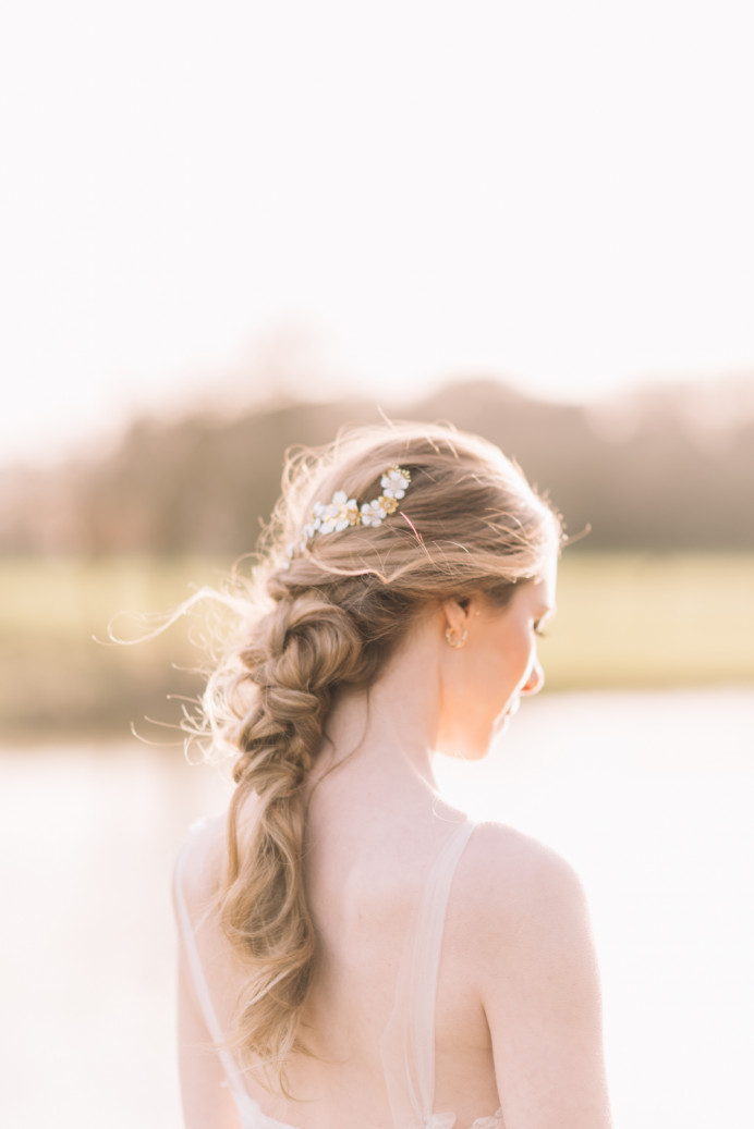 Jess's Hair was plaited and plaited again in this undone rustic hair up. Detailed golden accessories by Wilde Bride - Make Me Bridal Artist: Melissa Clare Makeup & Hair. Photography by: Lucie Watson. #bohemian #rustic #romantichairup #plaits #halfup #woodland