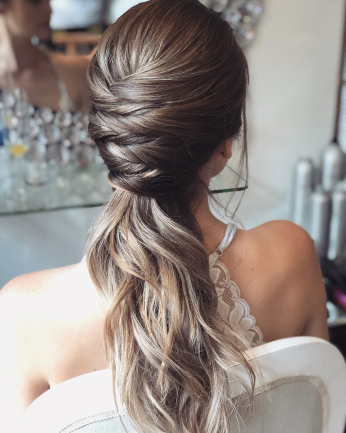 Twisted hair detail leading into a low ponytail for a bride getting married at Rivervale Barn in Berkshire - Make Me Bridal Artist: Melissa Clare Makeup & Hair. #weddinghair #ponytail #hairup #twists